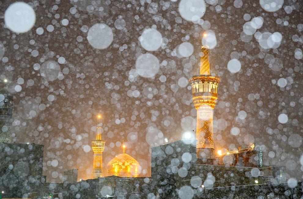 عکس حرم امام رضا در روز برفی