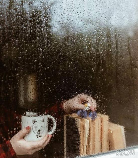 عکس باران و پنجره