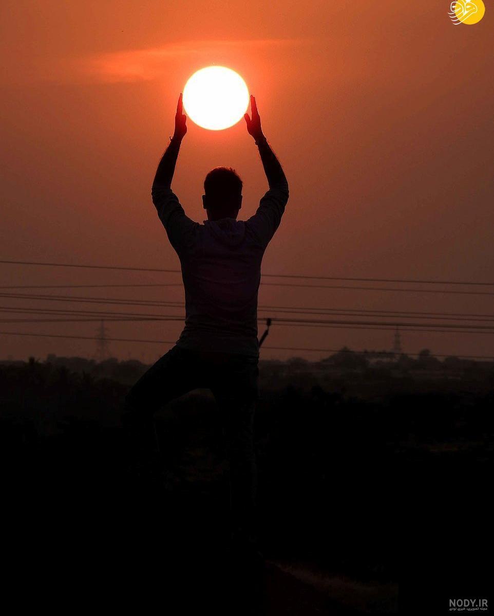 عکس خورشید در دست
